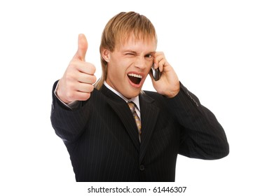 portrait of young blond man in suit speaking on phone and showing tumb up on white
