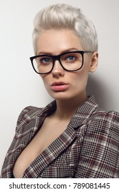 Portrait of young blond stylish woman in glasses