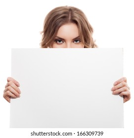 Portrait of a young blond woman holding a white blank banner. Isolated
