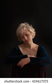 Portrait of Young blond woman on black background - studio shot - romantic moment -  text space
