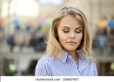 Portrait of a young blonde with eyes closed. Beautiful model blonde girl makeup.