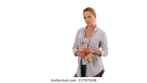 Portrait of young blonde female horticulturist posing on white background
