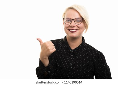 Portrait of young blonde female teacher wearing glasses showing thumb up gesture isolated on white background with copyspace advertising area