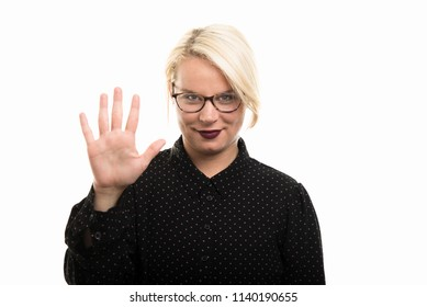 Portrait of young blonde female teacher wearing glasses showing number five with fingers isolated on white background with copyspace advertising area