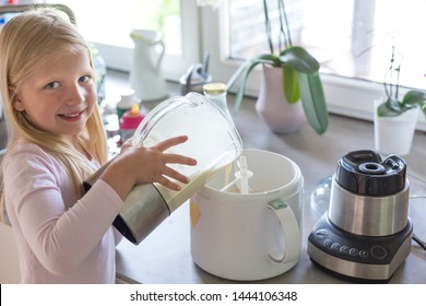 Portrait of young blonde girl making ice cream