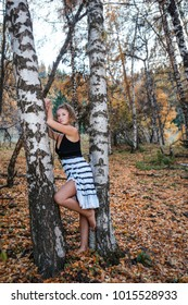 Portrait of young blonde woman at the nature in bitch tree forest. Autumn photo session in Kimasar mountain gorge, Almaty region, Kazakhstan
