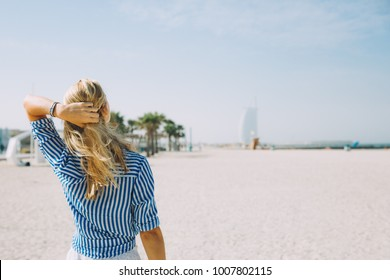Portrait of young blonde woman on the beach