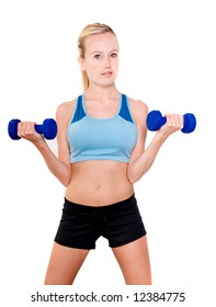 Portrait of a young blonde woman in sport wear lifting weights in the gym