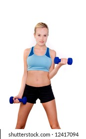 Portrait of a young blonde woman in sport wear lifting hand weights in the gym