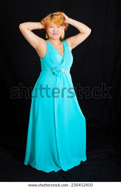 portrait of young blonde woman wearing a long blue dress