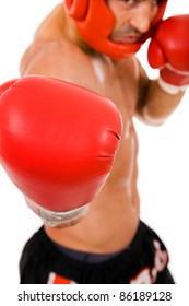 Portrait of young Boxer fighter with boxing helmet and gloves over white background. focus on gloves
