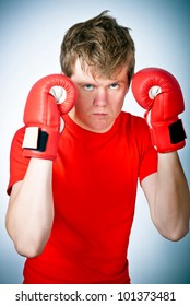 portrait of a young boxer with red gloves