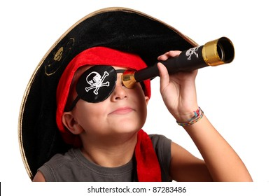 portrait of young boy dressed as pirate