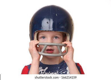 Portrait of a young boy with a football helmet on white background