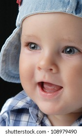 portrait of a young boy with happy eyes