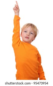 Portrait of a young boy with his finger uo isolated on white background