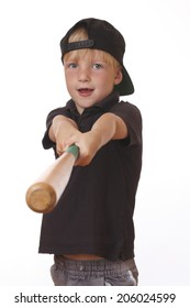 Portrait of a young boy holding a baseball bat on white background
