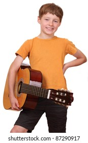 Portrait of a young boy holding a classical guitar