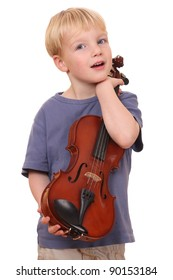 Portrait of a young boy holding his violin