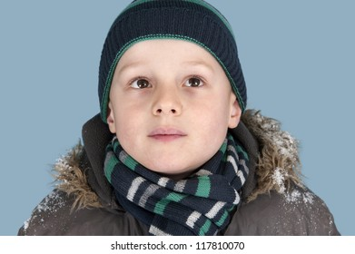 portrait of young boy with knitted hat and scarf
