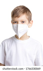 Portrait of young boy in medical mask over white background