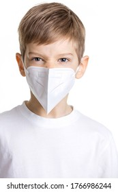 Portrait of young boy in medical mask making angry face over white background