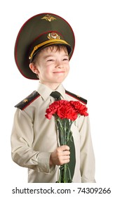 Portrait of young boy in Ministry of Defense Russian Federation cap and military uniform with red flowers