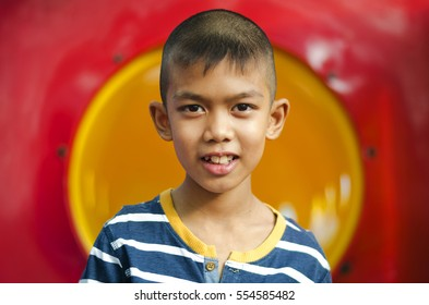 Portrait of Young Boy in Park.