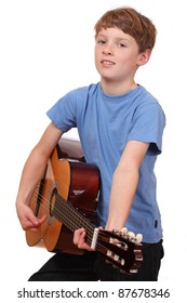 Portrait of a young boy playing a classical guitar