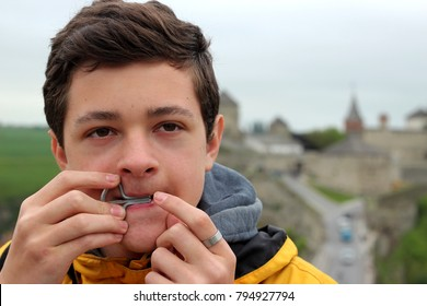 Portrait of young boy playing Jaw harp, one of the oldest musician instrument in the world, Ukrainian history and culture