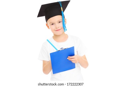 A portrait of a young boy in student's hat posing over white background
