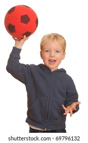 Portrait of a young boy throwing a red ball