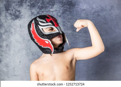 Portrait of a young boy with a wrestler mask