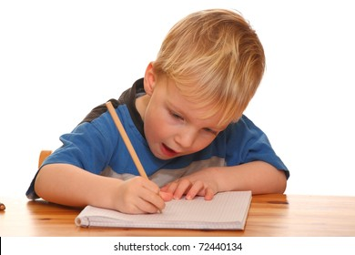Portrait of a young boy writing isolated on white background