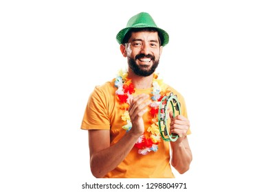 Portrait of young brazilian man wearing carnival costume
