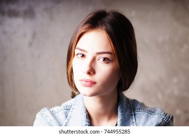 Portrait of a young bright beautiful European girls in the denim jacket