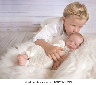 portrait of young brother with newborn baby, newborn and family photography