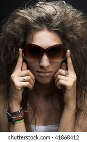 Portrait of young  brunette in big sunglasses