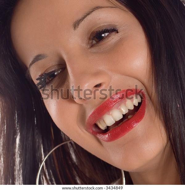Portrait a young brunette expressive smiling girl