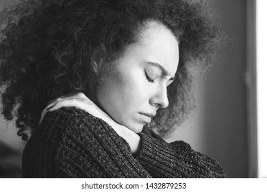 Portrait of young brunette woman, annoyed and frustrated. Mental disorders bulimia, addiction. Sadness, nostlagic, depression. Mental problems of young people. Black and white photo.