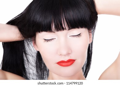 Portrait of young brunette woman with closed eyes