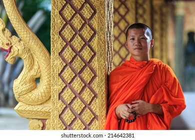 Portrait of a young Buddhist monk, looking in camera