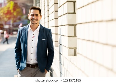 Portrait young business handsome man casual with happy outdoor on urban.