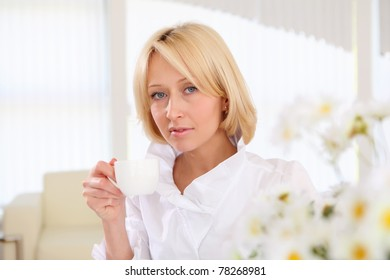 portrait of young business lady holding a tea cup