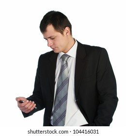 Portrait young business man in black suit communicating using mobile phone over white background