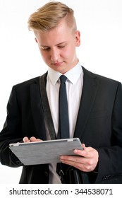 portrait of a young business man in black suit with tablet PC