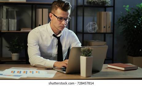 Portrait of young business man in casual shirt try working with anoying head ache in the laptop in the stylish office.