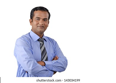 Portrait of young business man with folded hands against background