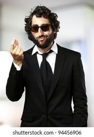 portrait of young business man gesturing money indoor