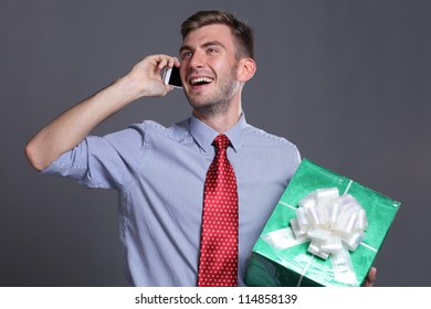 Portrait of young business man with gift